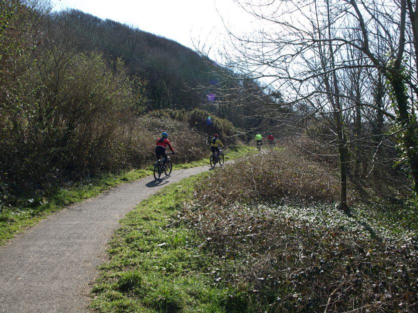 Cyclists climbing steep section of the Tarka Trail near Ilfracombe